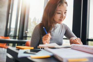 Practise writing essay outlines during JC Economics tuition
