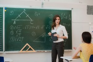 A teacher teaching in a classroom