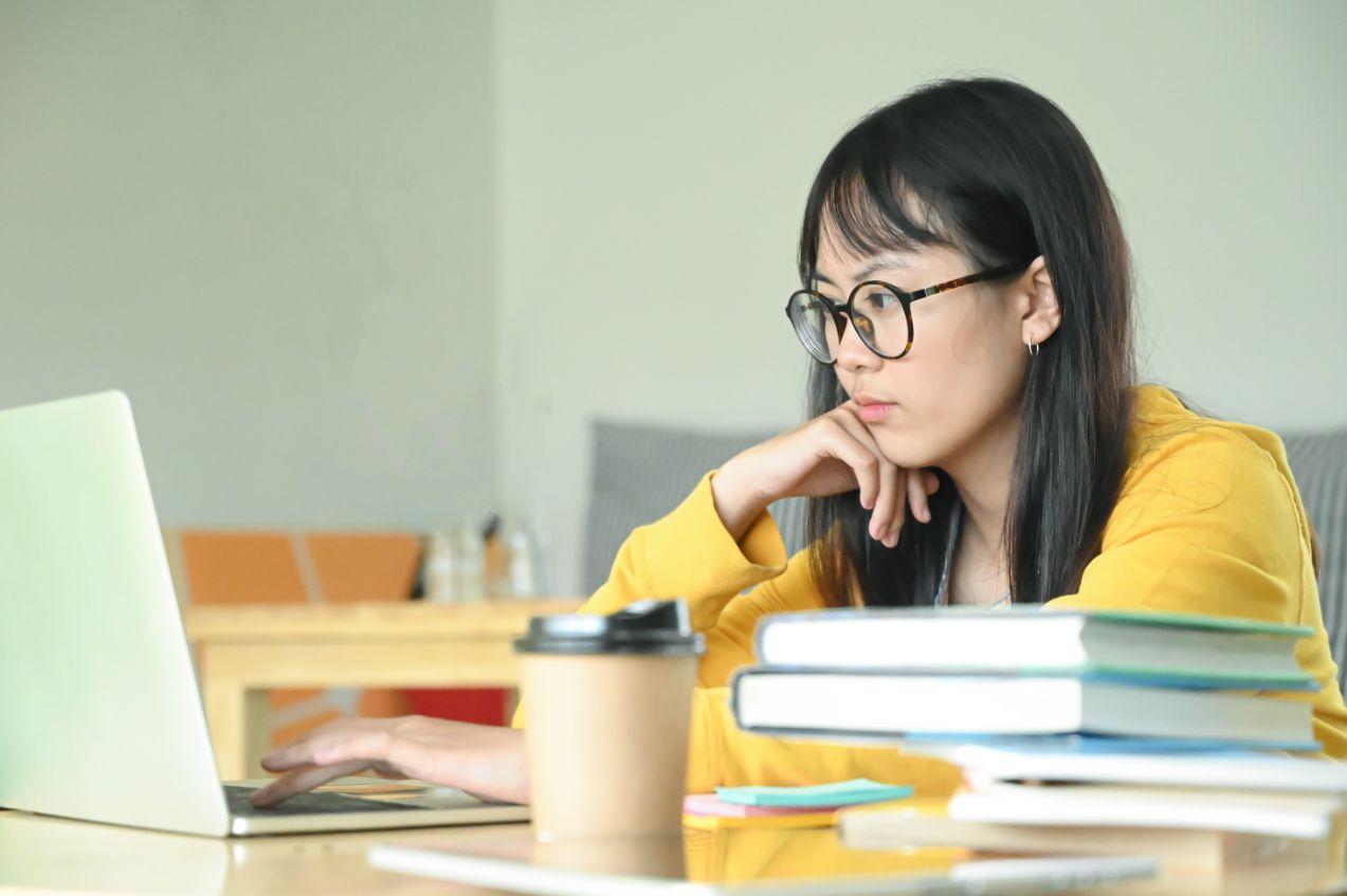Teenage Girl having Economics Tuition