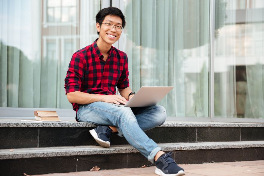 Teenager Using Laptop for Economics Tuition