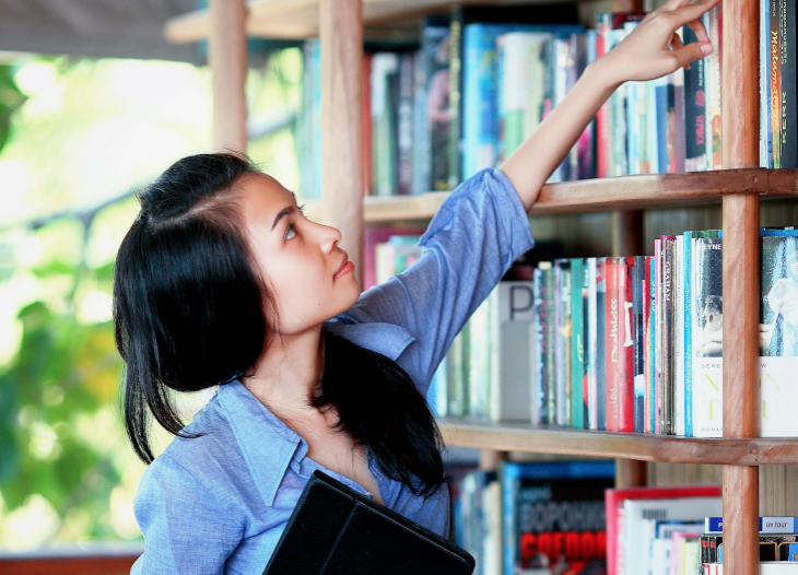 Girl In Library Having GP Tuition