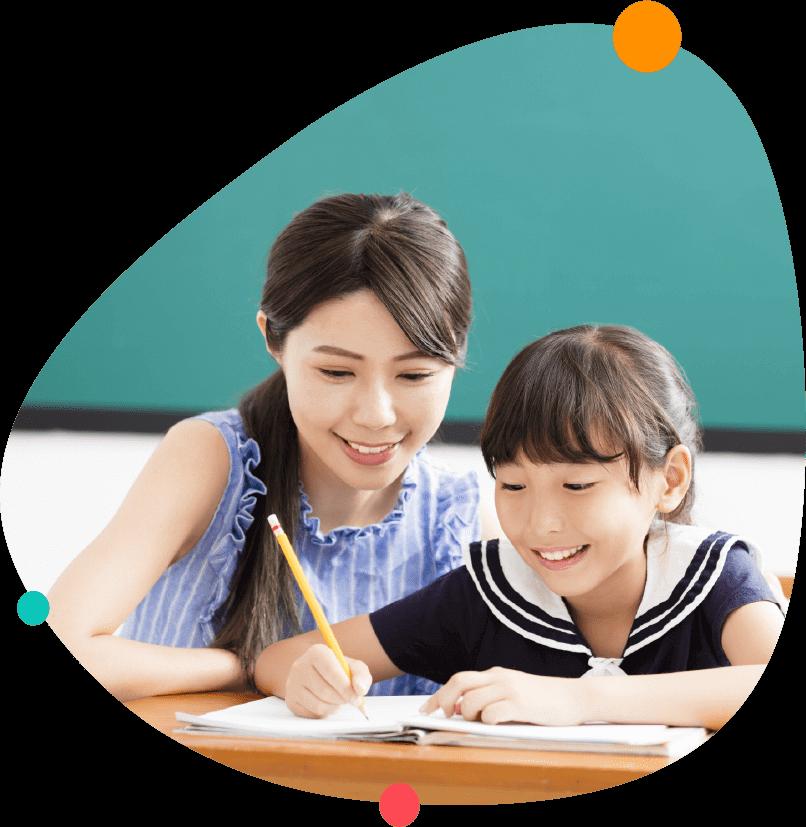 Primary School Tutor Conducting A Lesson